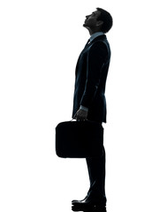 business man standing looking up silhouette