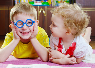 Funny brother in glasses with sister