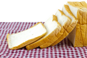wheaten bread sliced, on The plaid fabric