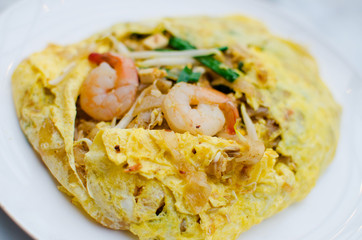 Fried noodle wrapped with eggs, Thai style food