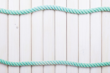 White wooden planks with rope background