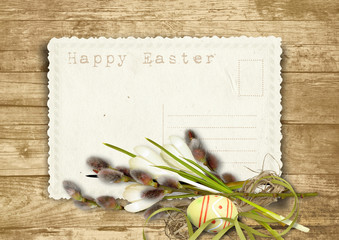Vintage Easter card  with pussy-willow on a wooden background