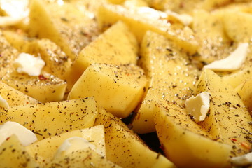 Raw potatoes with spices ready to be roasted