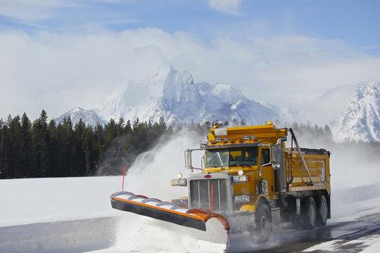 Snow Plow dump truck in Teton national park after blizzard