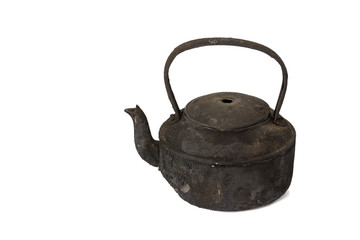 Old sooty kettle isolated on white background