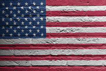 Brick wall with a painting of a flag, USA