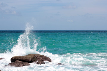 sea ​​waves splashing on the rocks