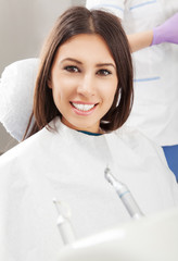 Happy Young Woman Patient at Dentist