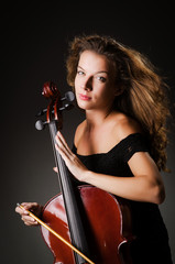 Woman performer with cello  in studio