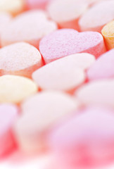 Sweet hearts shaped pink and orange Sugar Pills. Soft Focus.
