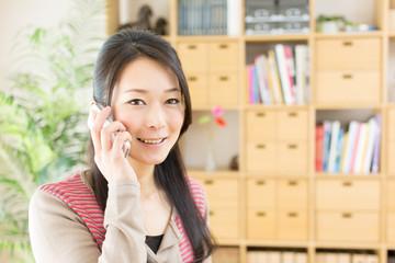 Beautiful asian woman using a cellular