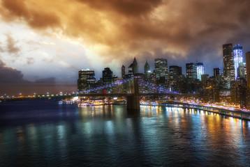 New York City. Wonderful sunset view of Brooklyn Bridge and Manh