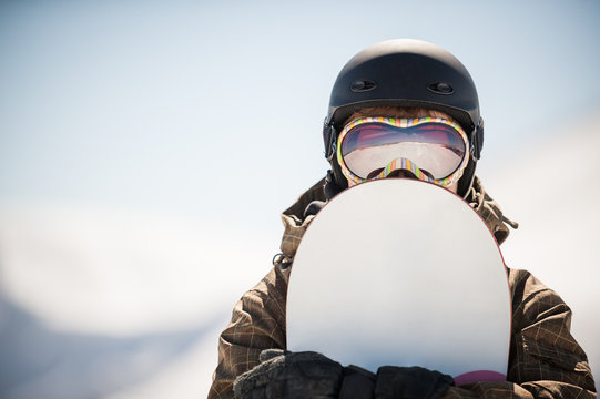 snowboard and snowboarder