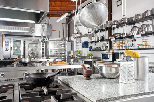 Utensils On Counter In Commercial Kitchen