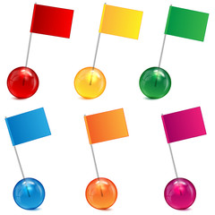 varicoloured marbles and  flags on a white background