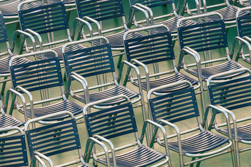 Rows of outdoor steel chairs