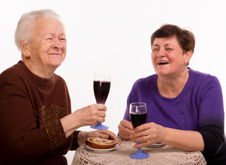 Happy mother with daughter drinking wine