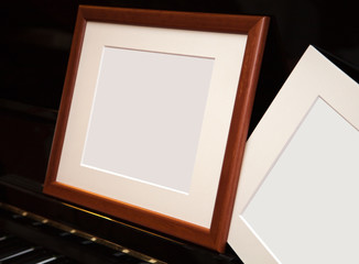 An empty frame on a pianoforte