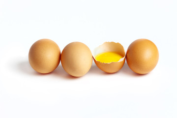 Four fresh eggs are located on a white background
