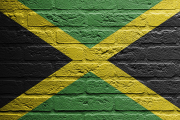 Brick wall with a painting of a flag, Jamaica