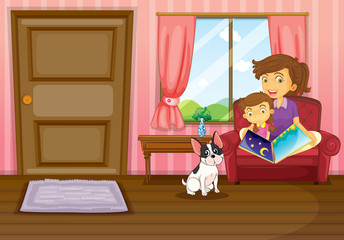 A mother and a girl reading with a dog inside the house