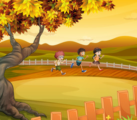 Three kids running along the field