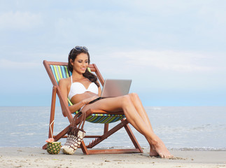 A lovely woman relaxing on a sky and sea background