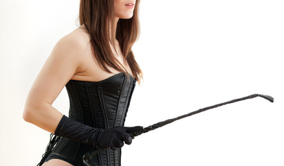 woman in a corset and  riding crop