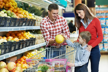 Wall Mural - Family with child shopping fruits