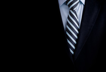 Black business suit with a tie and copyspace background