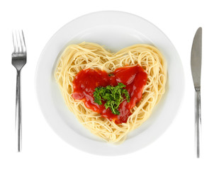Cooked spaghetti carefully arranged in  heart shape and topped