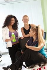 Girls talking at the gym
