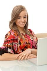Smiling girl browsing internet on laptop