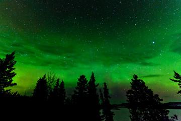 Green glow of Northern Lights or Aurora borealis