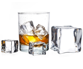 glass of whisky with ice cubes isolated on white