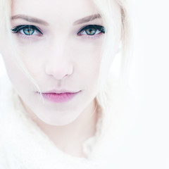fashion portrait of a beautiful young woman close up