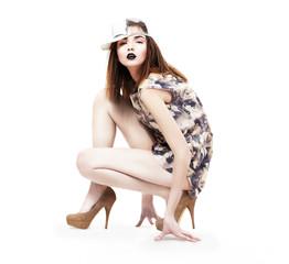 Glam. Nifty Ultramodern Woman sitting in Heels. Fashion & Glamor