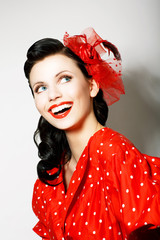 Retro Style. Happy Toothy Smiling Woman in Pin Up Red Dress