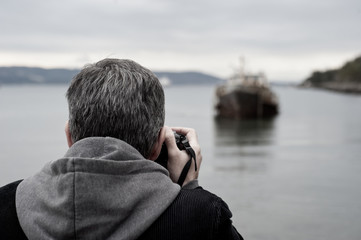 A man photographing a beautiful seascape