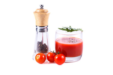 Tomato juice, tomatoes and pepper isolated over white background