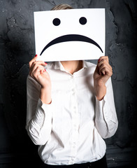 holding a blank paper with sad face