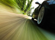 Side view of black car with heavy blurred motion.