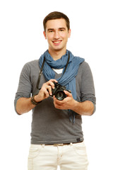 A portrait of a young photographer with a camera