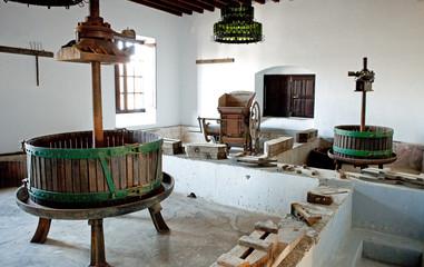 Old press for grape vine