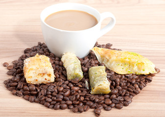 Coffee cup and coffee beans, sweets