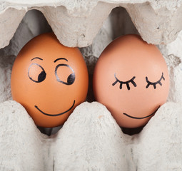 two funny smiling eggs in a packet