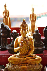Golden Buddha image in sitting posture