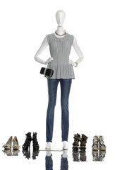 female clothes with shoes and bag on a mannequin