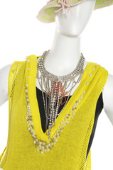 Fashion clothes in jewelry with hat on a mannequin