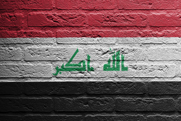 Brick wall with a painting of a flag, Iraq